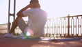 man doing abs exercises outdoor 44248562