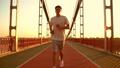 man runs along the bridge 44248564