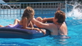 Smiling, happy children on a float in a swimming pool. 44253646