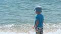 Little boy playing near sea 44253667