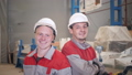Portrait Workers working with a crane in the warehouse. Smiling Looking at camera. the production of 44322409