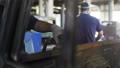 motion past employee grinding painted lorry cabin door in shop 44331486