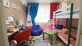 motion to bright boy and girl children room with funny toys 44331488
