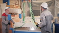 manufacture workshop. Workers adjusts the machine in the warehouse. the production of ventilation 44374122