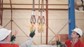 manufacture workshop. Hang the machine on the crane . Workers adjusts the machine in the warehouse 44374127