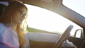 Woman driving car to work on sunny day 44374433