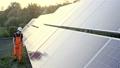 Technician inspecting solar panels 44406525