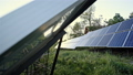 Two engineers are conducting outdoor inspection of solar photovoltaic panels 44406532