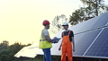 Two engineers working on checking and maintenance equipment in a solar power plant 44406534