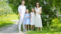 Family of four in blooming garden on beautiful spring day 44415756