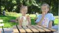 Beautiful elegant girl having breakfast at outdoor cafe 44415762