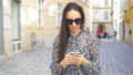 Woman walking in city. Young attractive tourist outdoors in european city 44415851