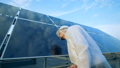 Man cleaning solar panels. Innovative industry concept. 44485788
