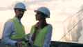 Engineers talk while standing near many sun batteries. FullHD. 44485802