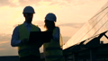 Woman and man on a roof on a sunset background, close up. 44485804