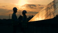 Professional engineers talk on a sunset background. 44485819