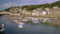 pan across the pretty harbour of Mousehole 44489244