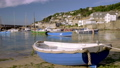 Camera rises to reveal harbour of Mousehole 44489295