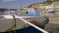 Camera slides to reveal harbour of Mousehole 44489296