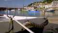 Camera rises  to reveal harbour of Mousehole 44489297