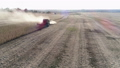 combine leaves trail of dust in its path during of harvest, beautiful agricultural scenery with 44505872