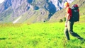 Hiking man walking on green mountain meadow with backpack. Summer sport and recreation concept. 44582951