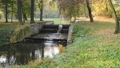 River bed with weir in the autumn. No camera motio 44703430