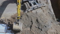 Heavy mining excavator loads rock ore into a dump- 44811995