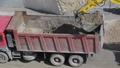 Heavy mining excavator loads rock ore into a dump- 44811997