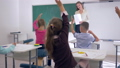 kids in school, children raise their hands to answer teachers question, schoolgirl goes to 44989103