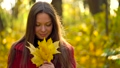 Beautiful girl walks in the autumn forest and enjoys good weather 44989445