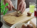 Cutting mushrooms on cutting board 44989655