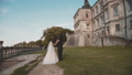 Wedding couple holds hand in hand, walks at castle and kisses each other 45006609