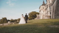 Back view of wedding couple walks at ancient castle 45006618