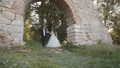 Happy wedding couple walks at castle with smiles on faces. Slowly 45006621