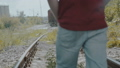 Young handsome boy walks on railway and thinking. FullHD 45006673