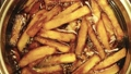 Homemade french fries are deep fried. Slow motion 45025365
