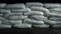 Passing Stacked Bags Of Drugs On Table 45119672