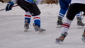 Men play hockey on a frozen lake. body parts 45137395