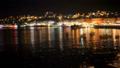 Bright lights are reflected in the dark sea water at the pier with boats. bokeh. 45272874