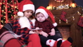 Two children in Christmas decorations playing smartphone 45278658