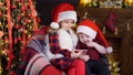Two children in Christmas decorations playing smartphone 45278659