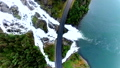 Norway. Powerful and beautiful waterfall passes under the highway. View from above. Aerial view. 45310068