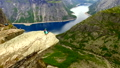 Norway. girl on the edge of the rock Trolltunga. aerial vie. 45310070