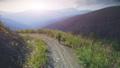 Man Traveler walking sunset mountain road 45520328