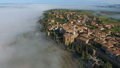 Old Italian city on top of hill in fog Tuscany 45625751