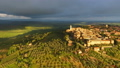 Old Italian city on top of hill at sunrise Tuscany 45625753