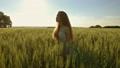 Beautiful girl walking in wheat field, slow motion 45625755
