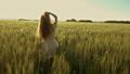 Beautiful girl walking in wheat field, slow motion 45625757