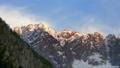 Mountain peaks are illuminated by light of sunset 45625777